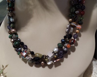 three strand Semi-precious stone designer necklace with assorted faceted stones.
