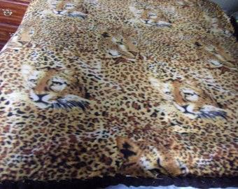 Leopard print handmade fleece blanket with braided edge