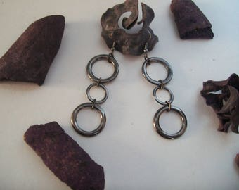 Black earring with different ring size