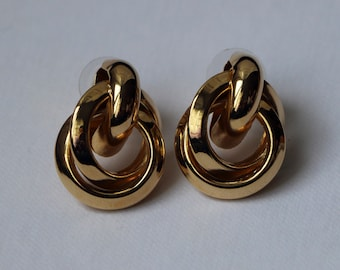 Free Shipping. Metal interlocking circles earrings in gold and silver.