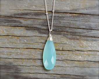 Aqua blue chalcedony necklace. Sterling silver blue chalcedony briolette necklace on a bead chain. Facate chalcedony teardrop pendant.