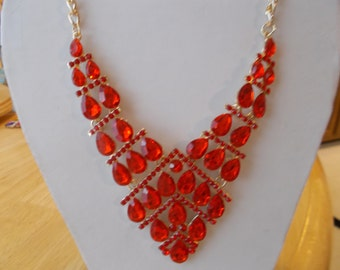 Bib Necklace with Red Crystal  Beads and Red Rhinestones  on a Gold Tone Chain
