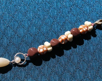 Brown and white pocketbook jewelry