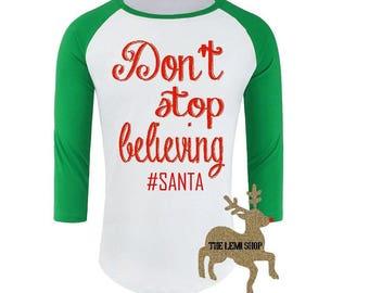 Christmas shirt. Funny christmas shirt. Don't stop believing. Santa shirt. Funny christmas t shirt. Christmas tee.