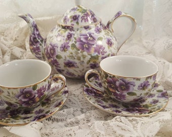 Chintz violets teapot with two teacups and saucers