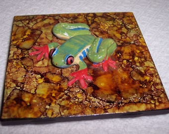 A Red eyed Tree Frog hand sculpted on a beautiful hand painted tile, coaster size, easel back