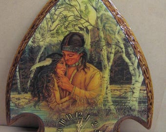 Indian couple in the woods on large arrowhead