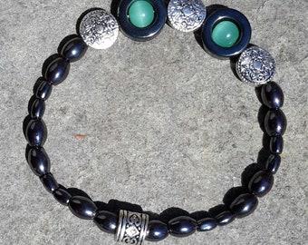 Hematite bead on its ela bracelet only.