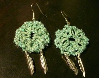Light green tatted lace and bead earrings with feathers