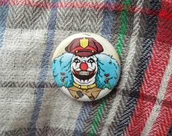 "Dr. Rockzo 1"" Button or Magnet Metalocalypse"