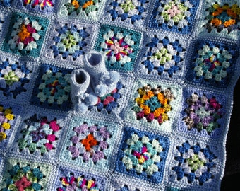 Crochet baby blanket. Multicolor blanket with booties