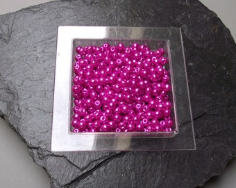 100 pink glass pearls 4 mm.