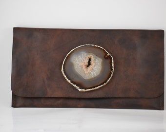 handmade brown cow leather clutch handbag with a brown agate geode crystal