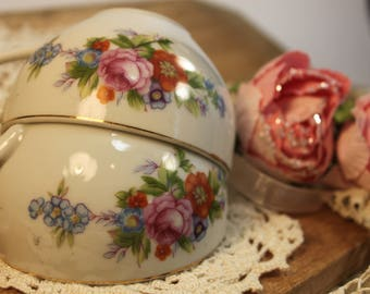 a pair of sweet tea cups with a floral pattern