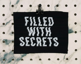 Filled with Secrets Patch screen printed black canvas Twin Peaks