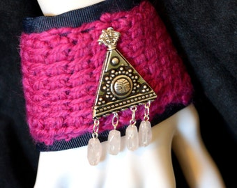 Wrist cuff/tattoo cover, Tunisian crocheted pink wool over navy blue gorse grain ribbon, real silver triangle and rose quarts deco