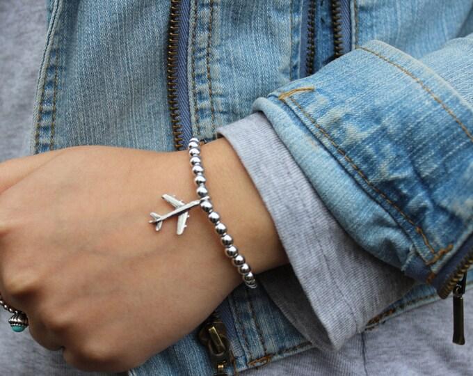 The Wanderlust Travel Bracelet in Silver.