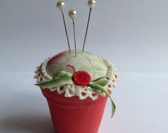 Painted Pretty Flowerpot Pincushion, perfect for storing loose pins.
