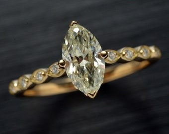 Diamond Engagement ring solitaire Marquise Shape in 18kt Yellow gold 1 carat center stone.