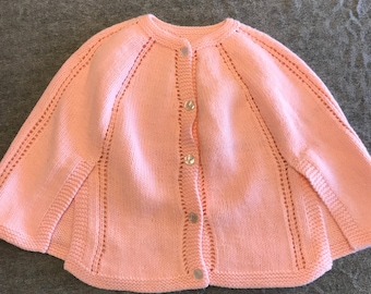 Hand knit pink cape