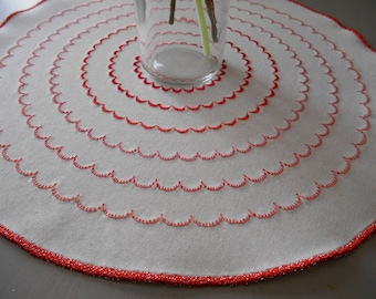 Red and white doily