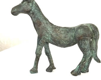 Sculpture of a bronze horse with antique green patina. sculpture one of a kind, lost wax casting method,