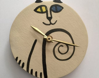 wall clock: cat round odd eyed white black ceramic hand made whimsical feline decor ***Ready to Ship