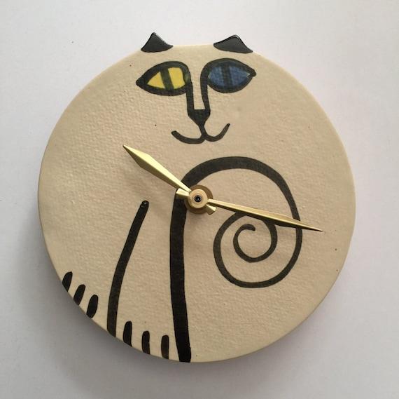 wall clock: cat round odd eyed white black ceramic hand made