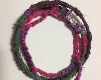 Bracelet; beautiful batiks and braiding, with tumbled amethyst