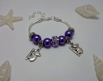 Purple charm's bracelet with charms ref 486