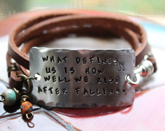 What defines us ...  Hand stamped triple wrap leather bracelet