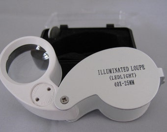 Sale-LED lighted magnifier loupe 40x-25mm complete with case and batteries.  For stamp collections, jewelry, crafts, coins and hobby making.