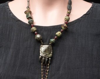 Gator Paw Juju necklace, rustic ceramic alligator foot with dangling gem chain and art bead necklace knotted on fine metallic leather