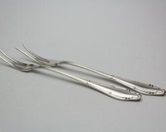 Two vintage meat forks