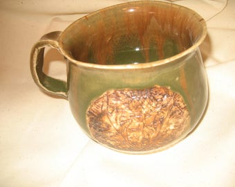thisle mug in green and brown and ofcourse the national flower of scotland. and all my carvings are hand madeby me.