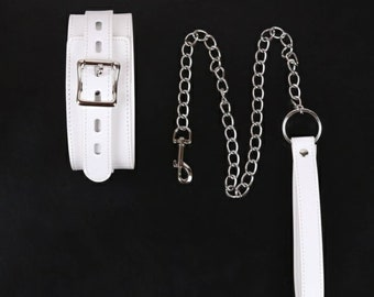 Large white lockable collar and leash set.