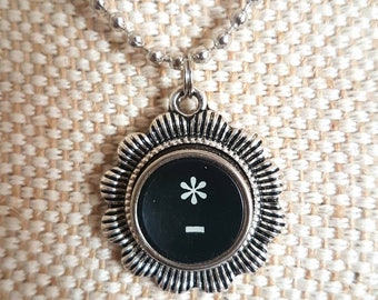 Black asterisk and dash necklace with flower surround/ typewriter key pendant / silvertone flower pendant