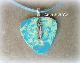 Vanilla turquoise triangular pendant made of polymer clay