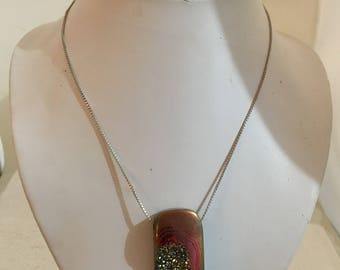 Gold druzy pendant on sterling silver chain.