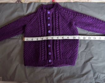 A purple baby cardigan