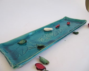 turquoise glazed ceramic tray with leaf inprint.