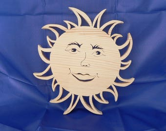 Sun face in woodcut