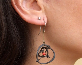 cage earrings.