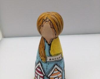 Miss August peg doll