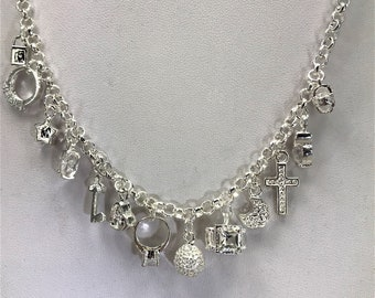 A Beautiful 925 Silver Multi charm Necklace. Matching Bracelet also available
