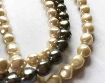 Triple strand pearl necklace. Vintage Avon necklace. White and black pearl necklace. Faux pearls. Vintage jewelry. Gift for her.