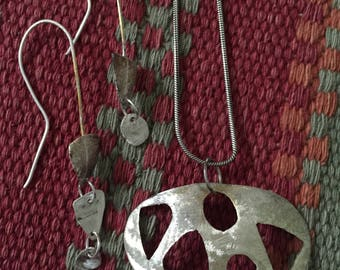 Handcrafted sterling silver pendant and earrings