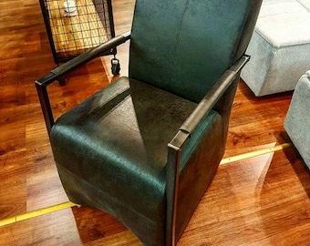 Black Leather armchair with metal frame on wheels Vintage, Retro, Modern, Industrial.