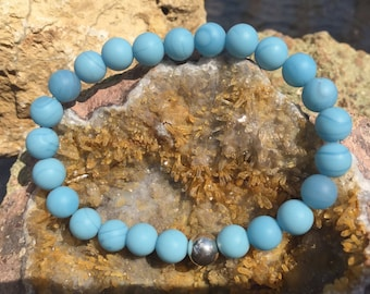 "Matte, powder blue ""sea glass"" and sterling silver stretch bracelet"