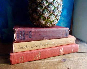 vintage book collection, Canadiana, Foot-loose In India, signed Sinclair, Wild Frontier, More Food That Really Schmecks, orange book decor